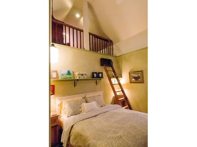 Master bedroom has ladder up to the loft