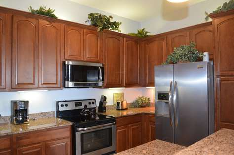 Fully equipped kitchen with stainless steel appliances, coffee maker, toaster, etc.