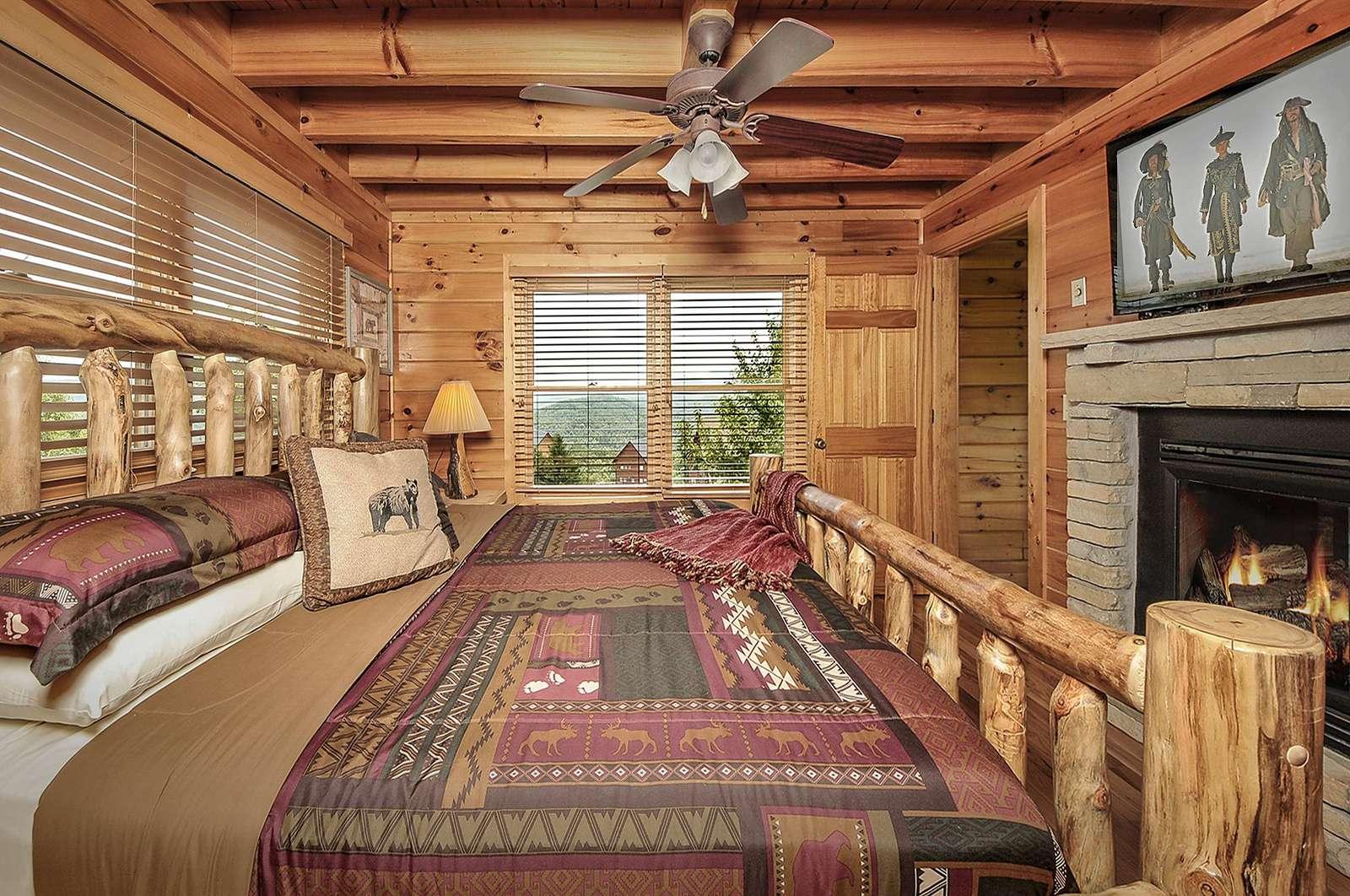 Main Floor Bedroom with 2-way Fireplace