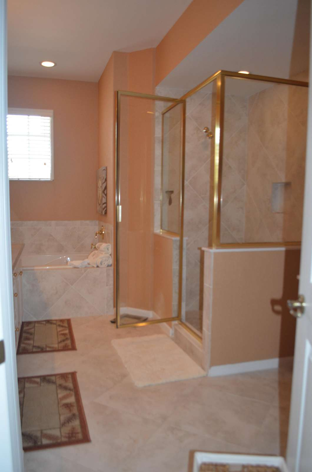 Large master bathroom with shower and Roman tub
