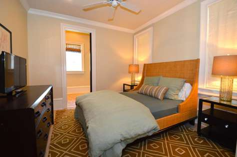 1st Floor Queen Bedroom: Queen Bed, TV and Private Bathroom