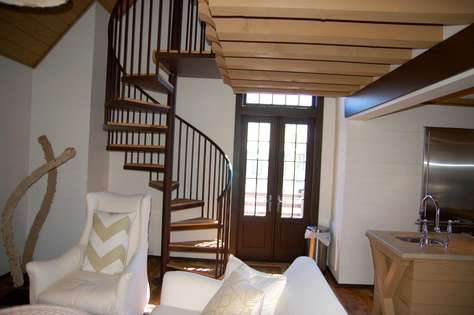 Spiral Staircase leads to Loft and King Bedroom