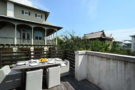 Sunny, upstairs terrace which also functions as an outdoor dining room and grilling area