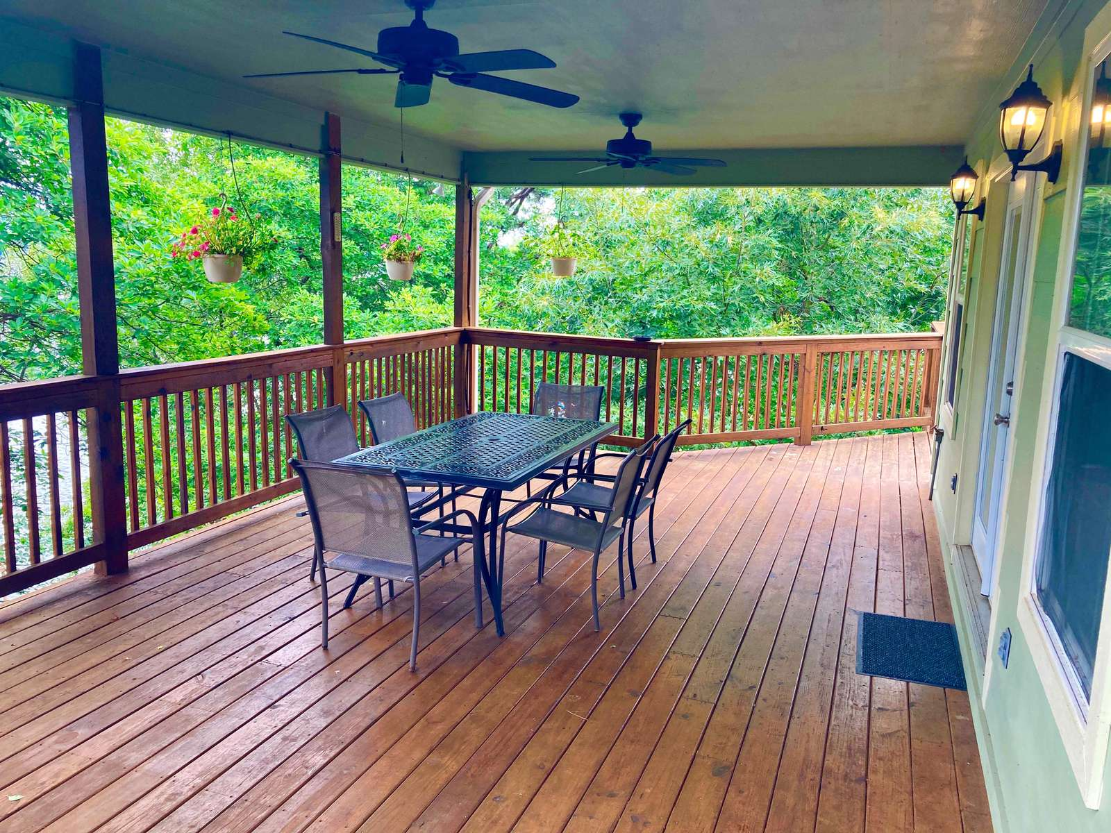 We weren't joking when we nicknamed the home the Big Treehouse. This porch is nestled in the trees. There's plenty more decks if you don't like heights! lol