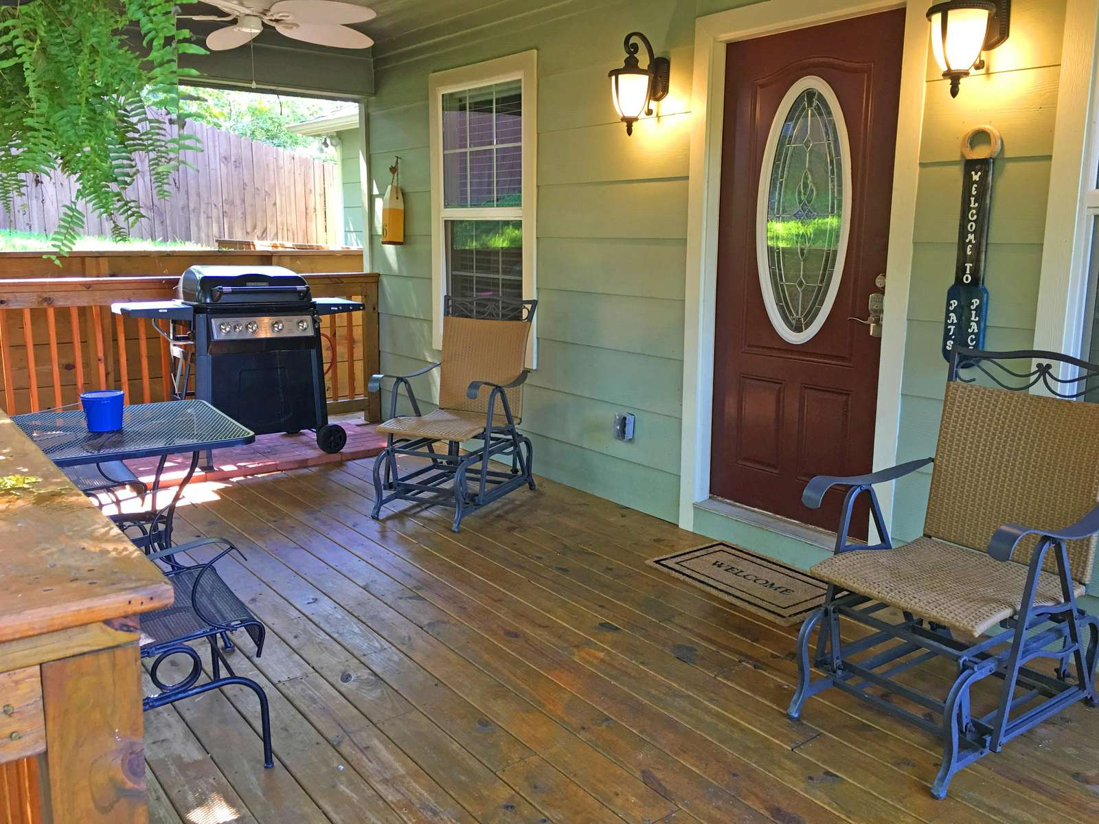 The front porch with gas grill, table, chairs and fans!  The grill is attached to a large tank (no running out of gas)