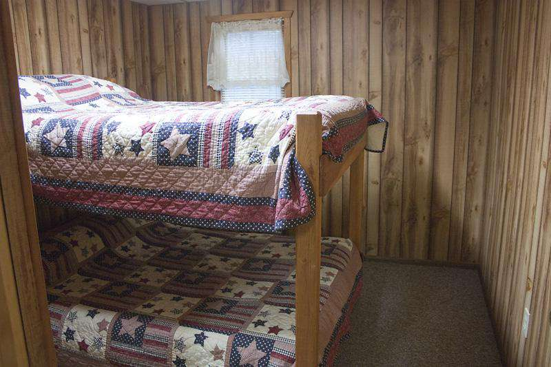 Second bedroom with set of double bunk beds.