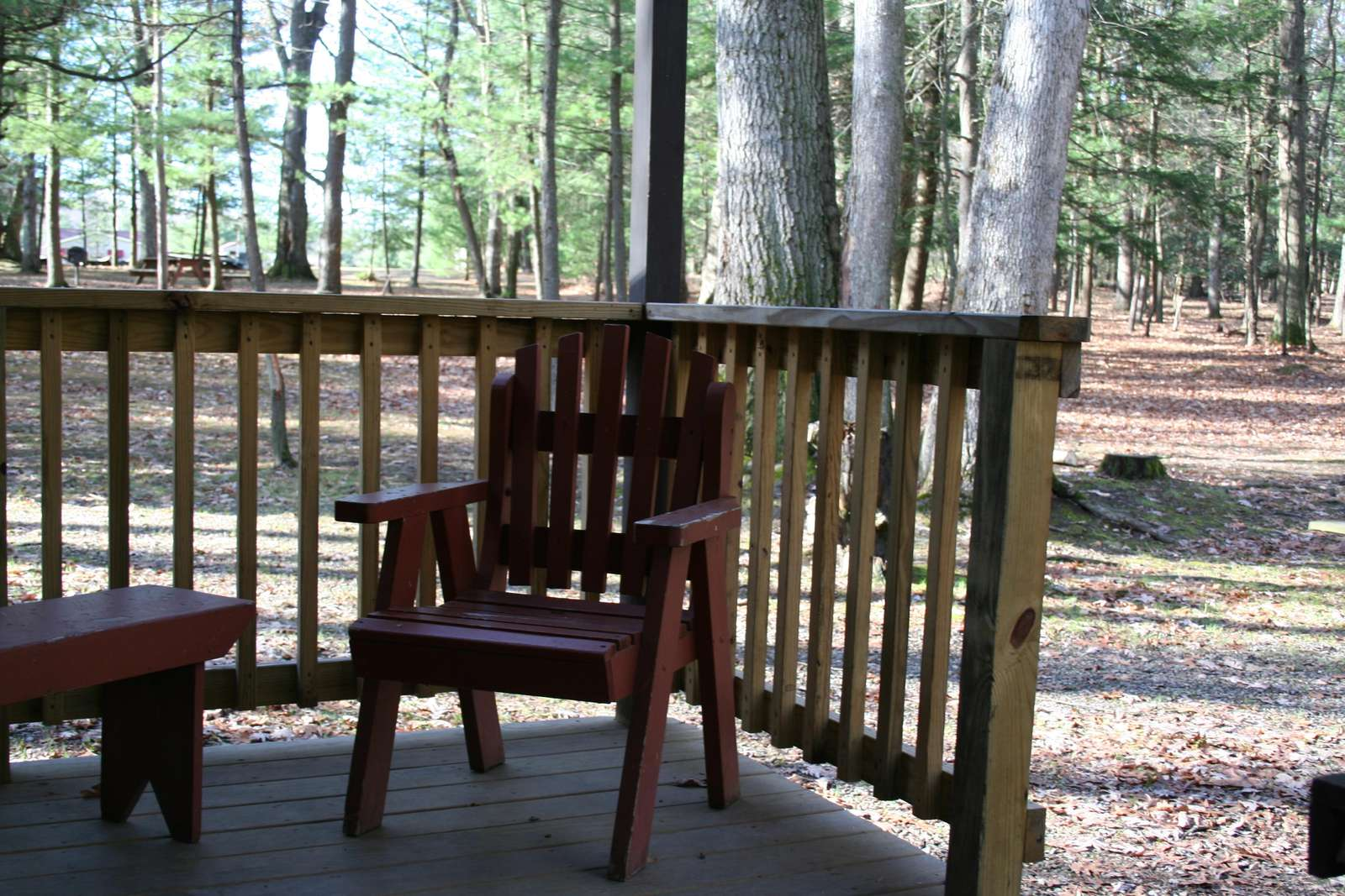 Back porch with wood porch furniture.