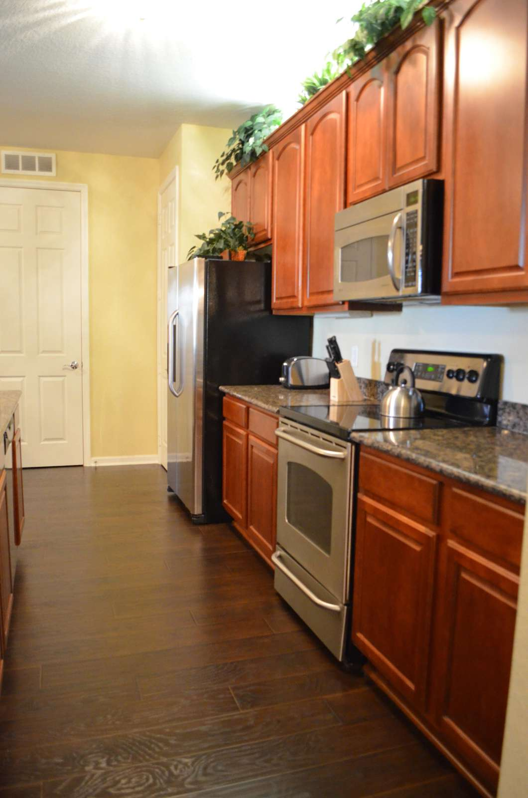 Stainless steel appliances in fully equipped kitchen