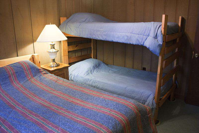 Third Bedroom with Queen Bed and a set of twin bunk beds. Ceiling Fan.
