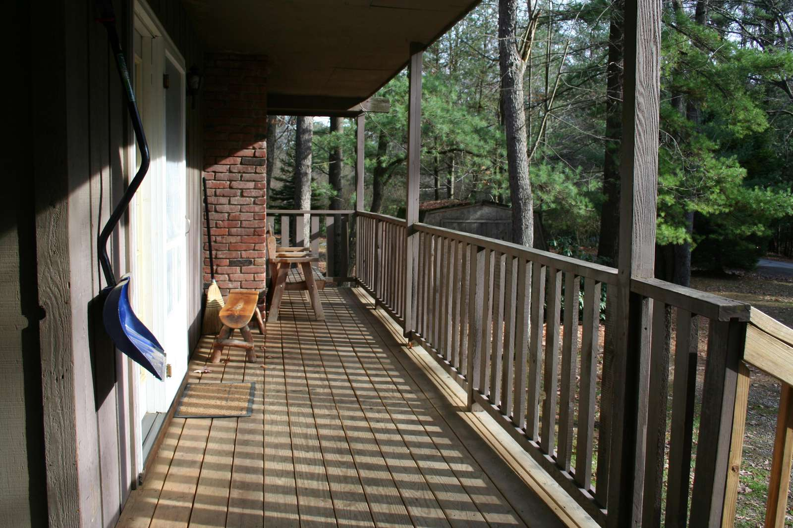 Front porch of Hemlock Haven Cabin that enters into the Kitchen.