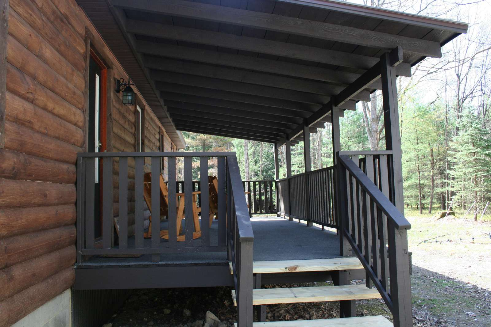 Steps up to Back Porch on Hidden Oaks Cabin