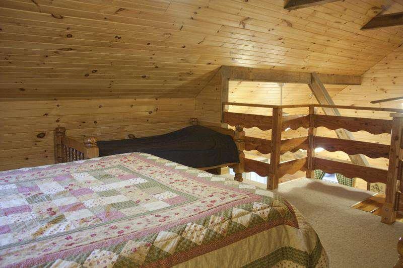 Loft Bedroom with Queen bed and 2 single beds.