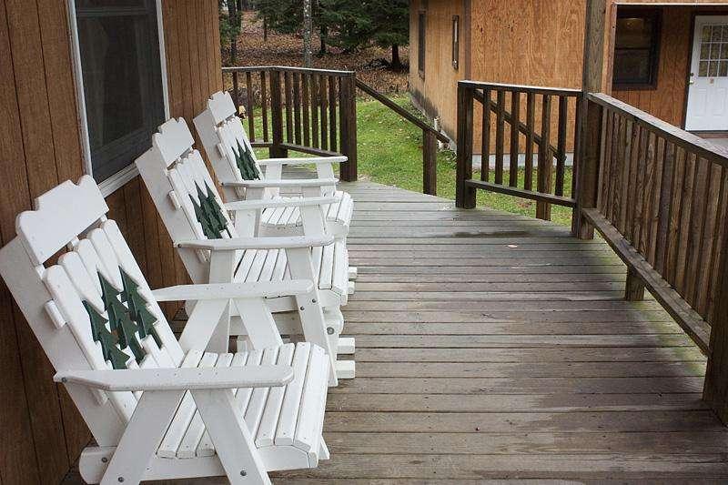 Large covered deck on Sunburst Locust Cabin.