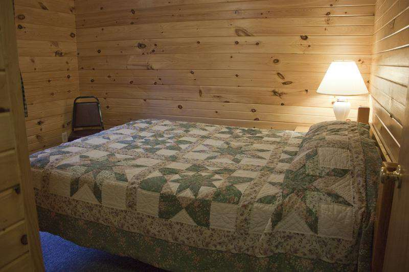 Downstairs, second bedroom with a Queen bed.