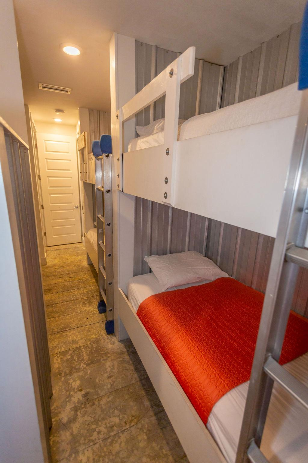 br # 3 has 3 sets of bunks/bath/private exit