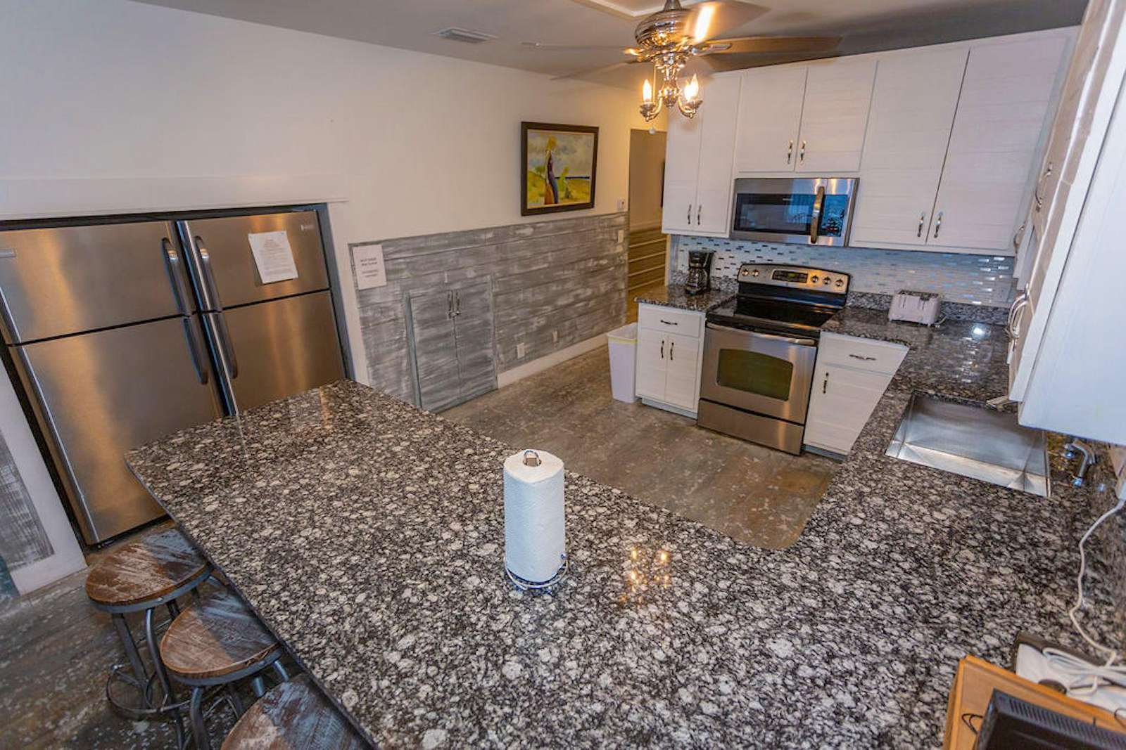 Fully stocked kitchen with 2 large refrigerators
