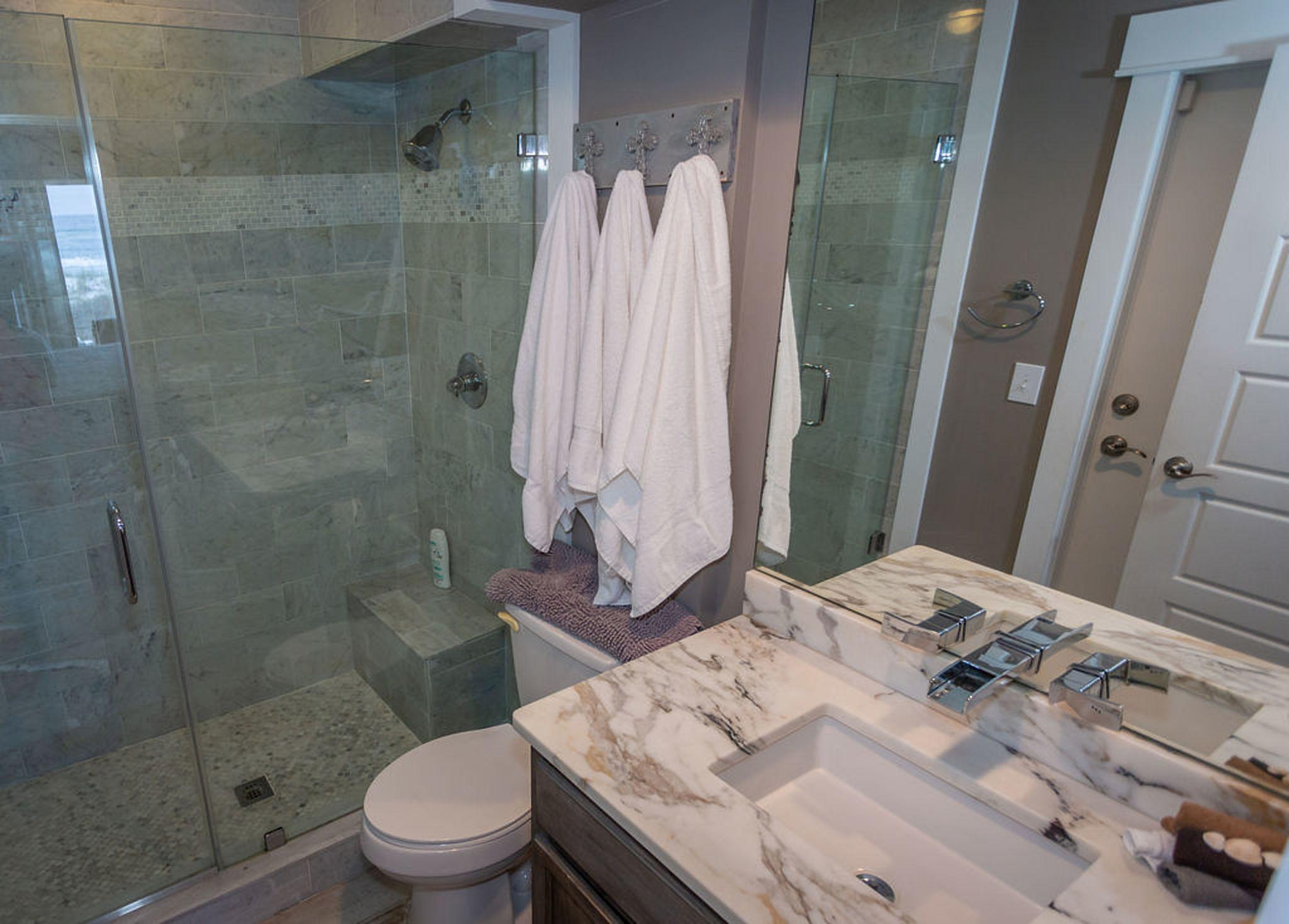 Bathroom #1 - large white Carrera marble shower with built-in bench