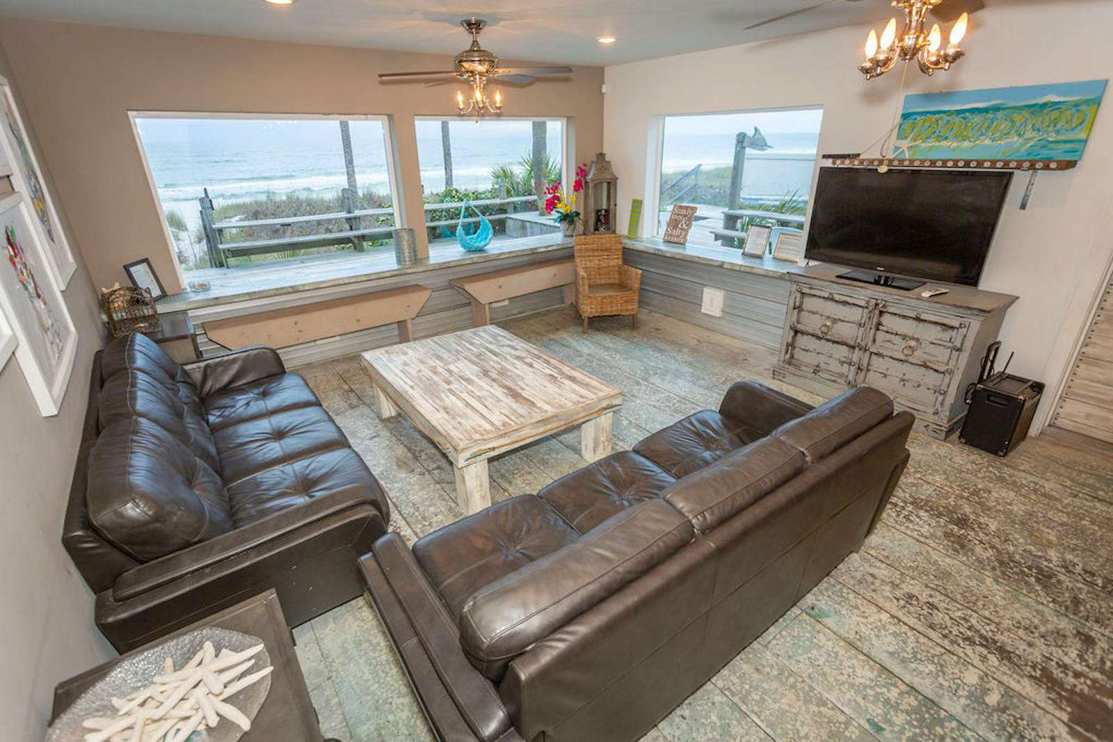 Family Room with 2 large sofas, flat screen, seating around bar-benches, bar, 4 barstools