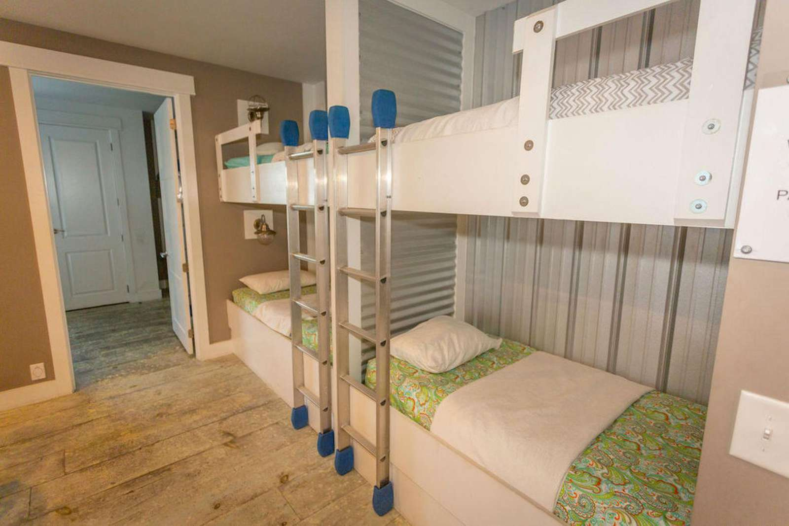 upstairs family room has 2 sets of bunks, large sectional flat screen