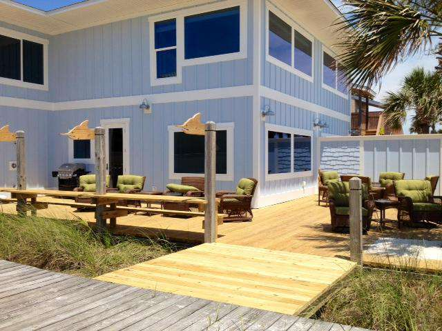 large deck with comfy tall chairs, rockers, gate opens in the middle if you rent both sides
