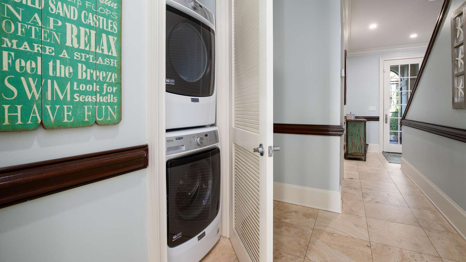 There is a large front load washer and dryer.