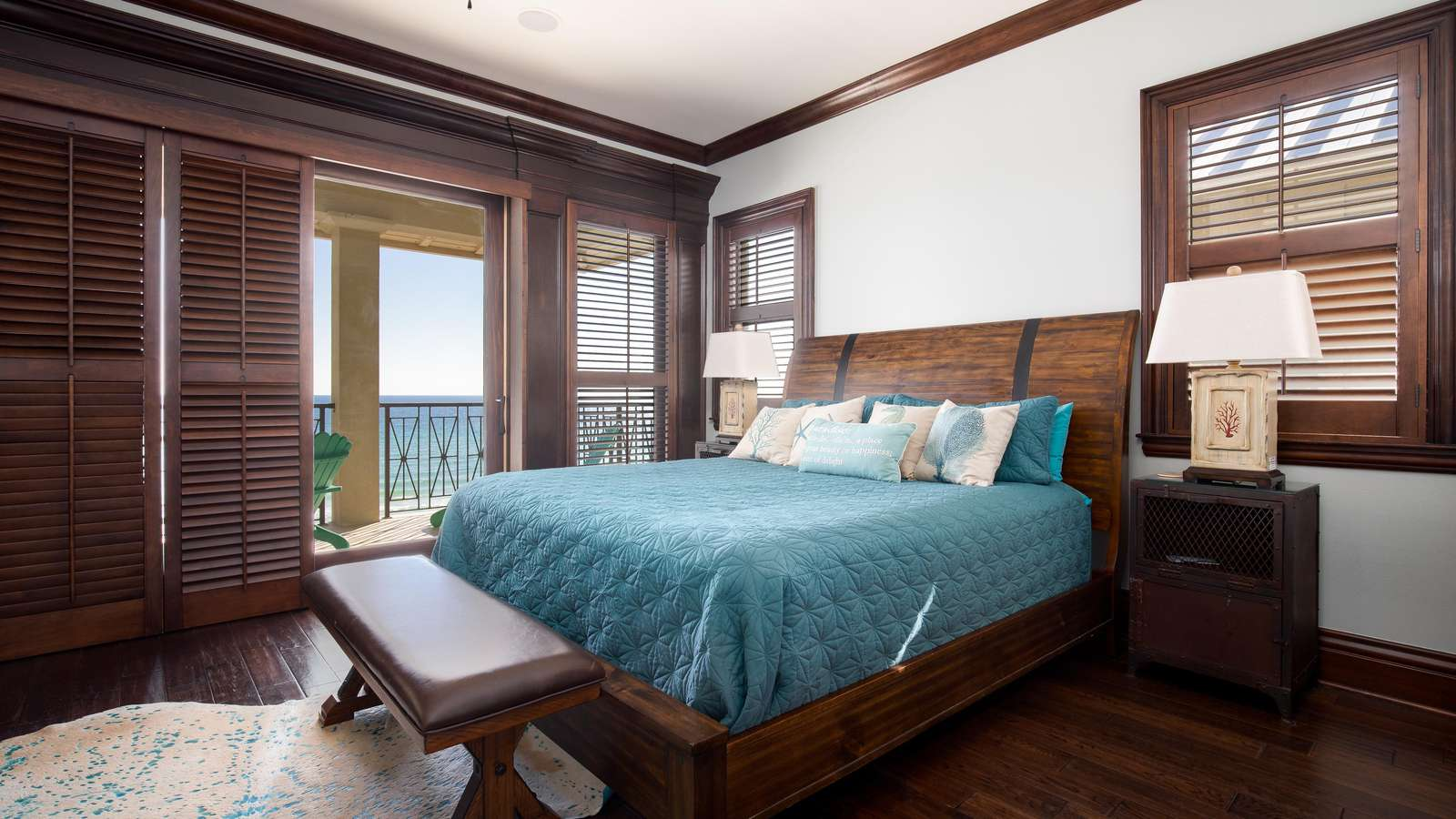 The luxurious master bedroom has a private balcony overlooking the ocean!