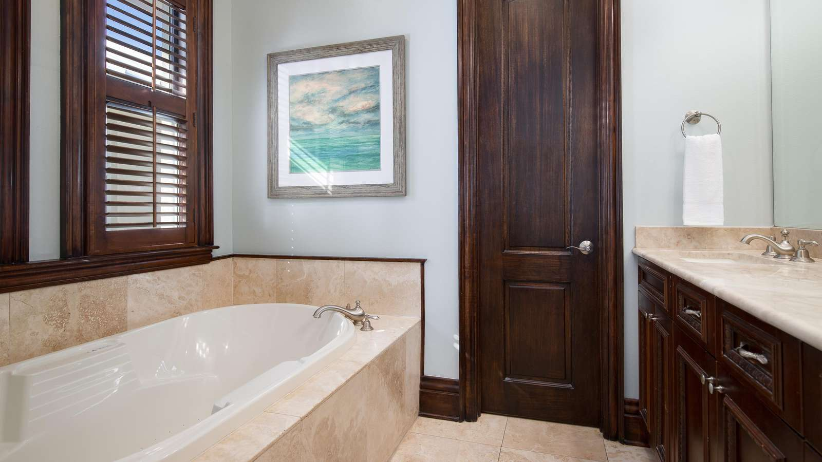 The large master bath features a huge soaking tub along with a separate walk in shower.