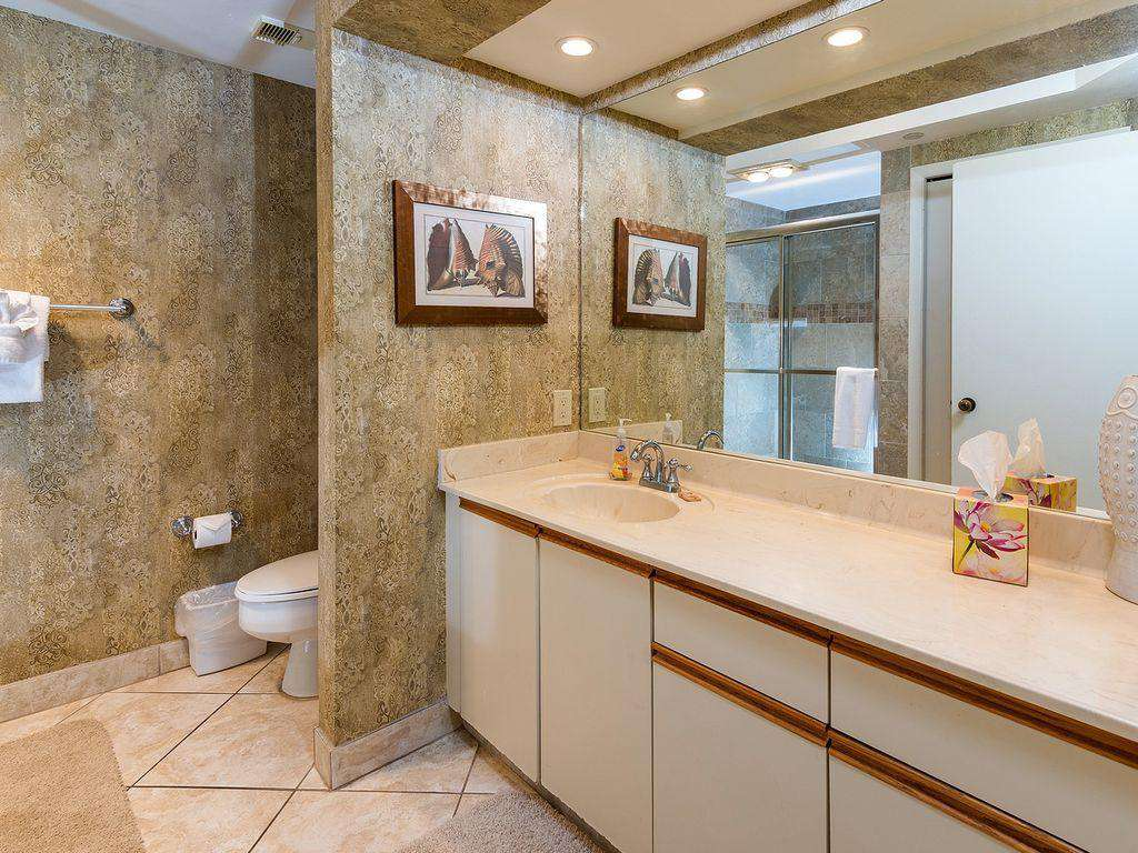 The master bathroom is spacious and bright.