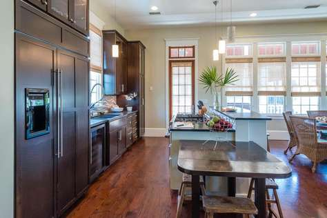 Large kitchen area with refrigerator freezer, wine cooler and bar seating