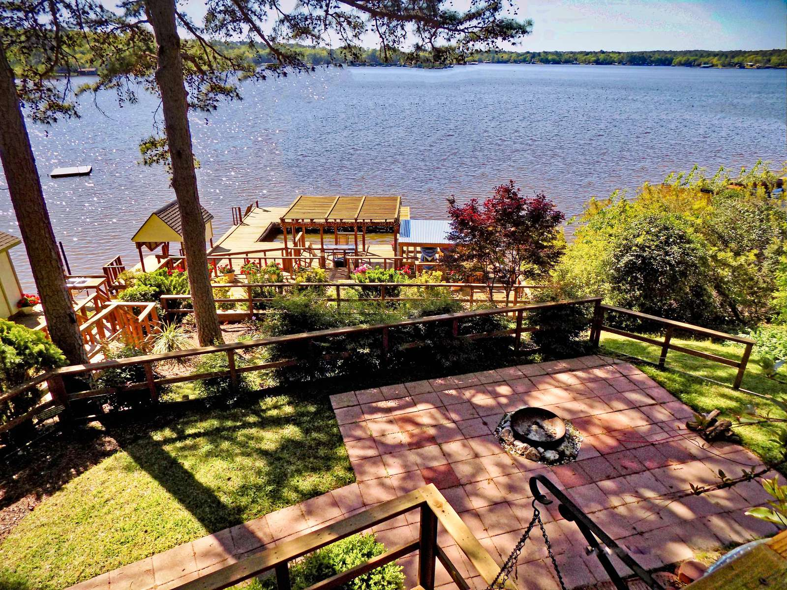 The view off the main deck is stunning. We love the water view with a shoreline not too distant. Take note of the firepit for making smores with the kids.