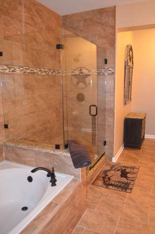 Custom made shower and Roman tub in master bathroom