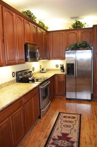 Fully equiped kitchen with stainless steel appliances