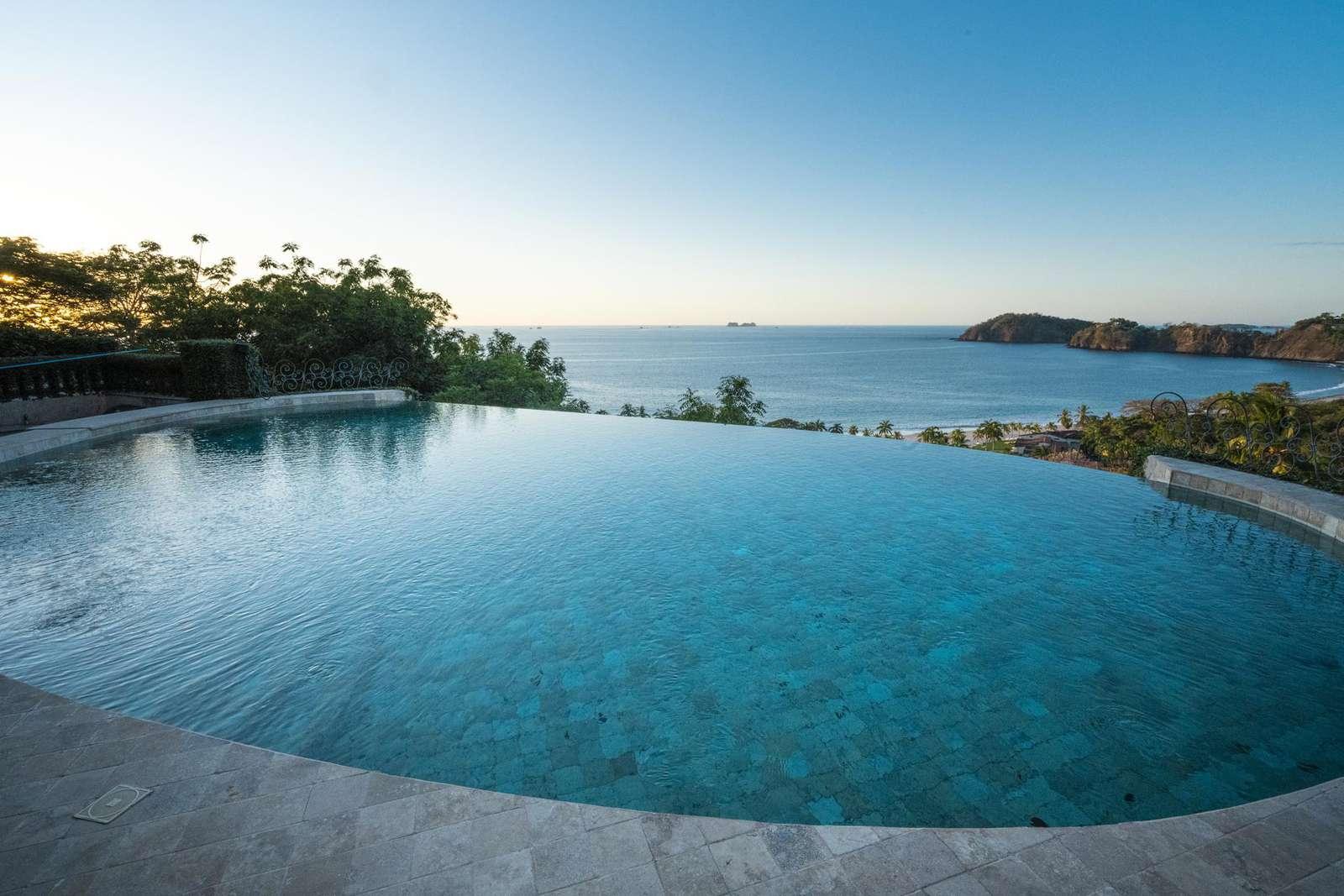 Large designer infinity edge pool overlooking the pacific ocean