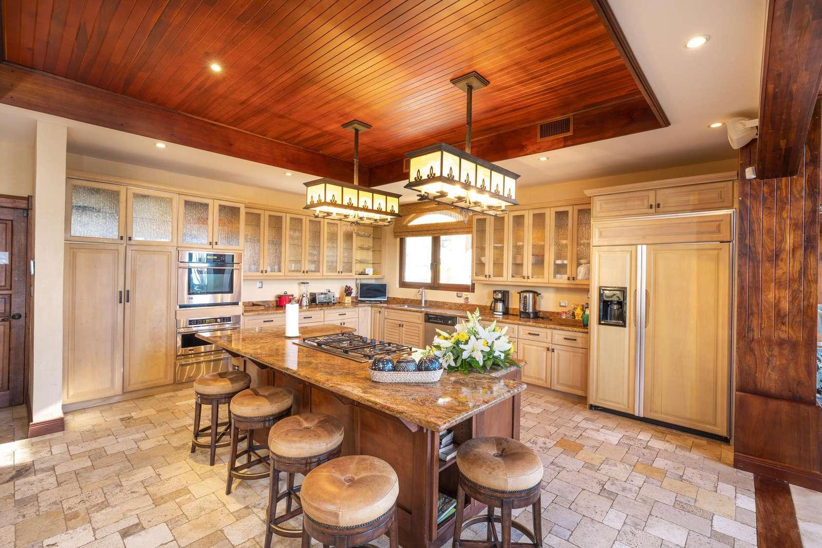 Gourmet kitchen, built in appliances, ice maker, breakfast bar