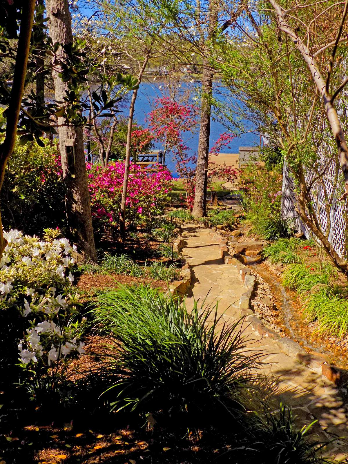 The stone walk down to the lake with a running brook that's pumped from the lake. Sit on the porch and feel the stress melt away.