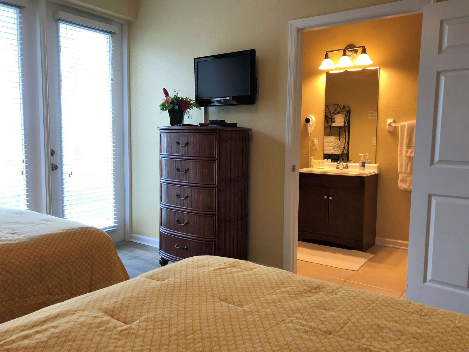 Flat screen TV and DVD player; en-suite bathroom first floor in background