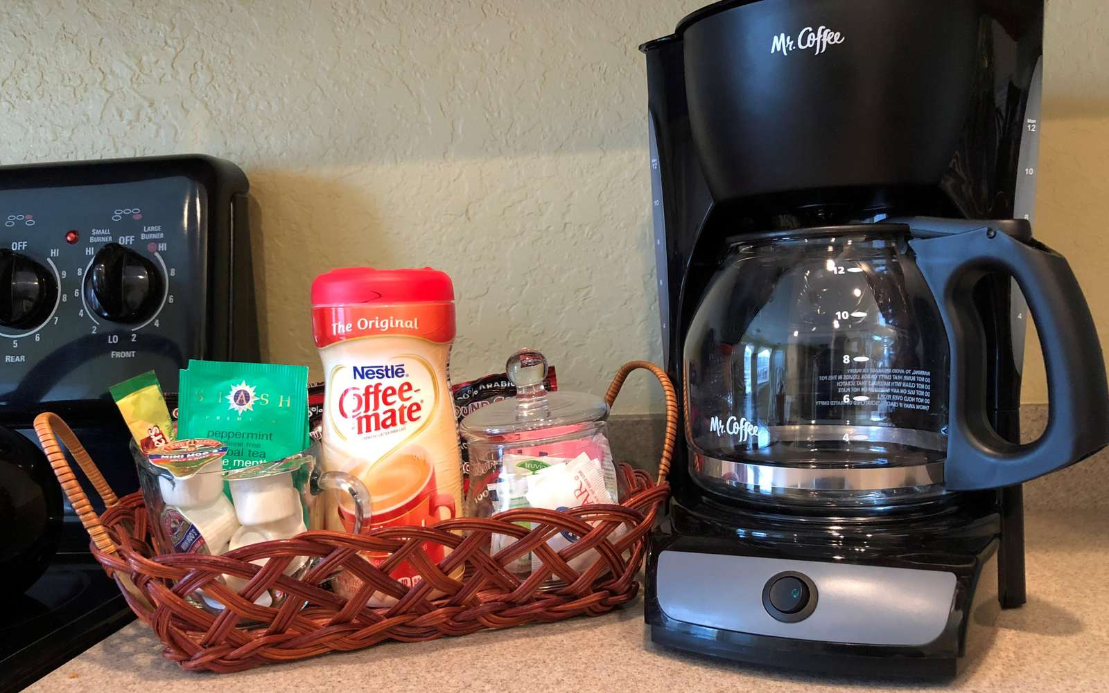A starter kit with coffee, filters, sugar and creamer