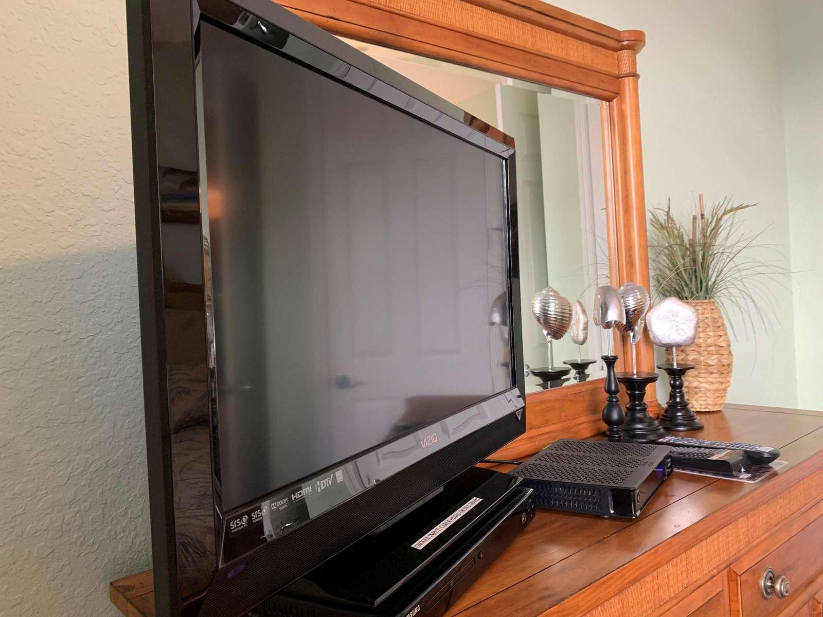 TV and DVD player in queen bedroom