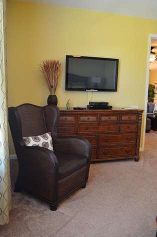 Sitting area in master with flatscreen TV and DVD player