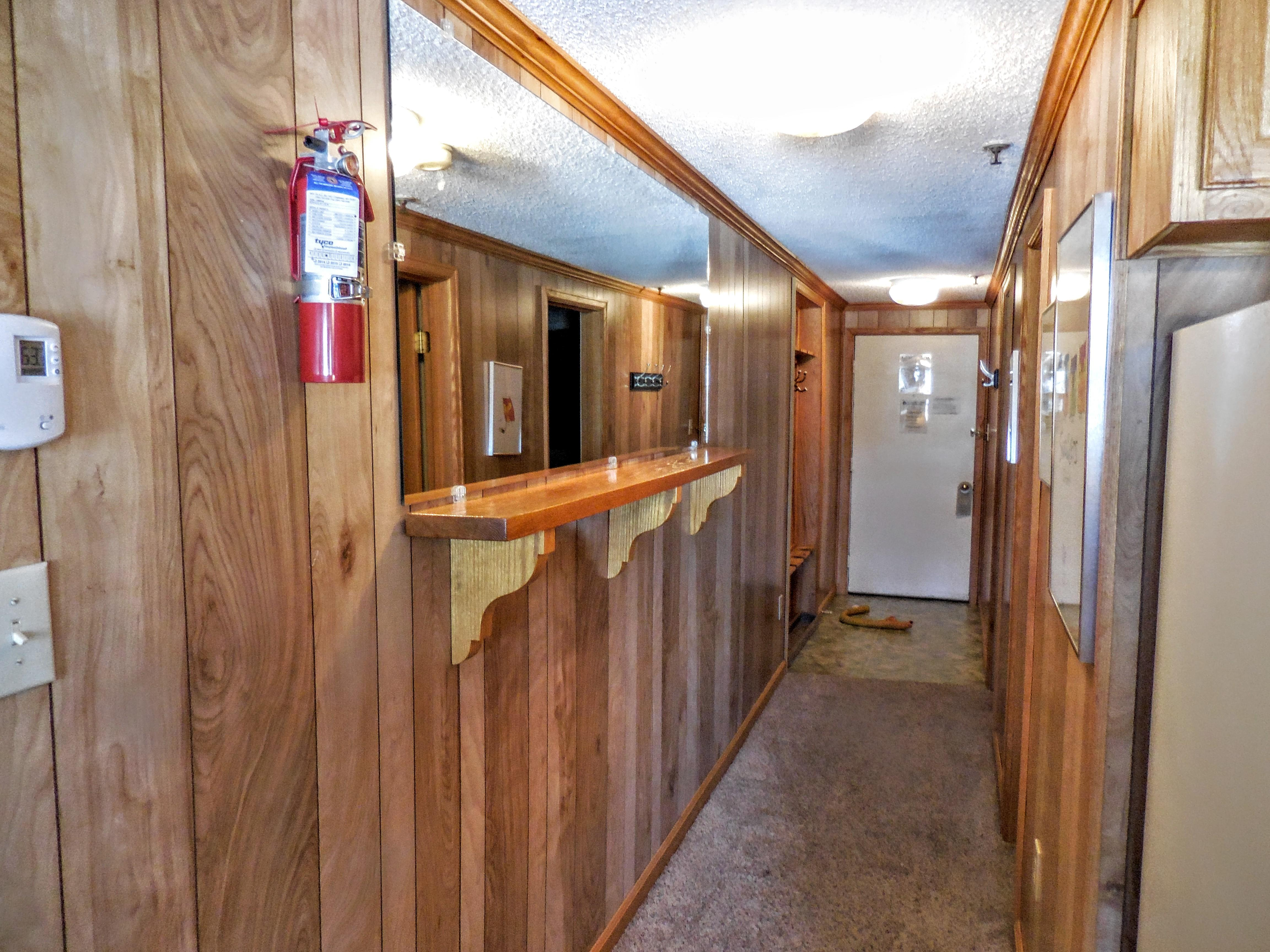 Oak paneling throughout living area and hallway