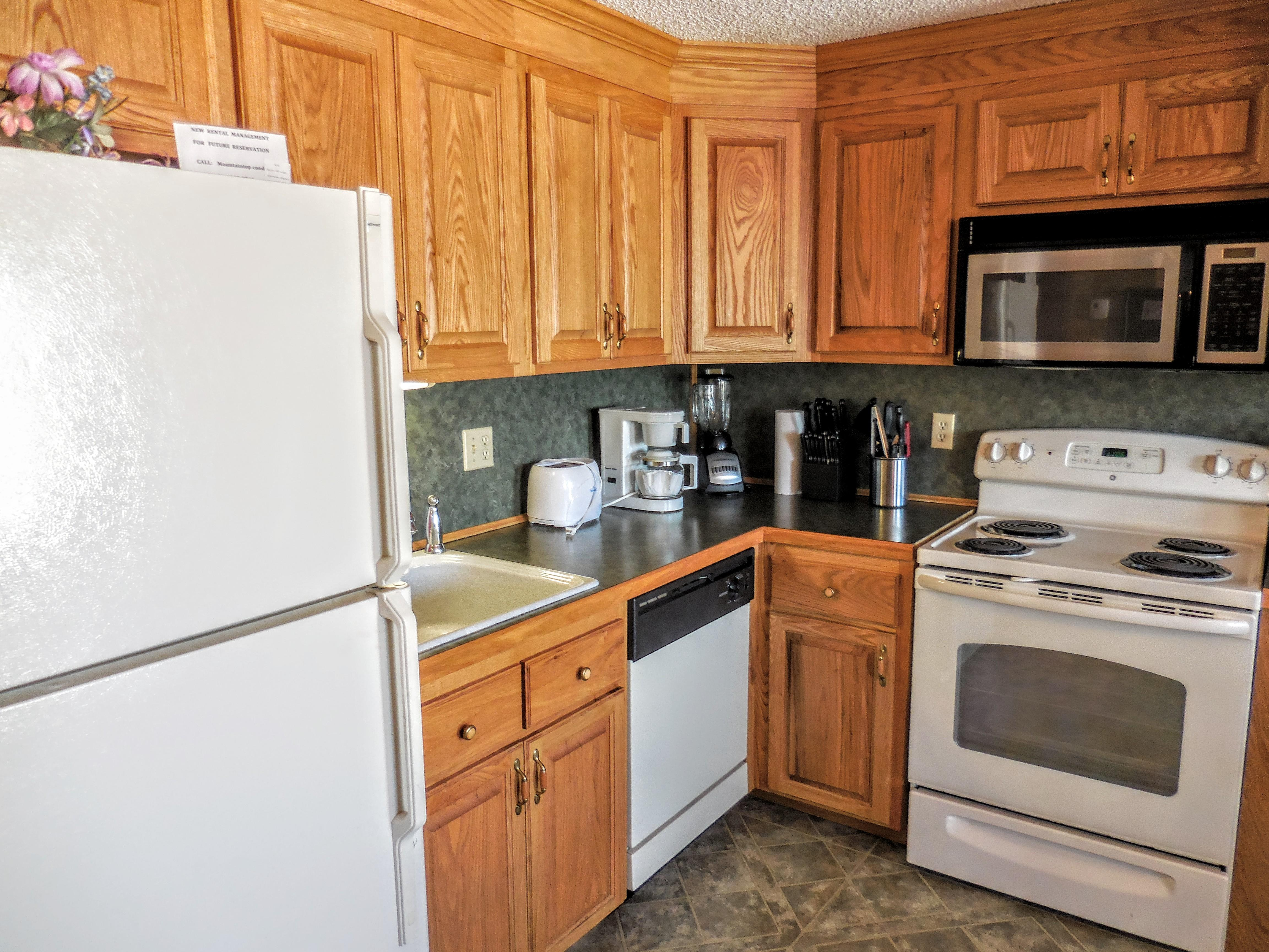 Fully-equipped kitchen with pots, pans, utensils, etc.