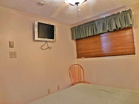 Flat-Screen TV in bedroom with DISH Network HD channels!