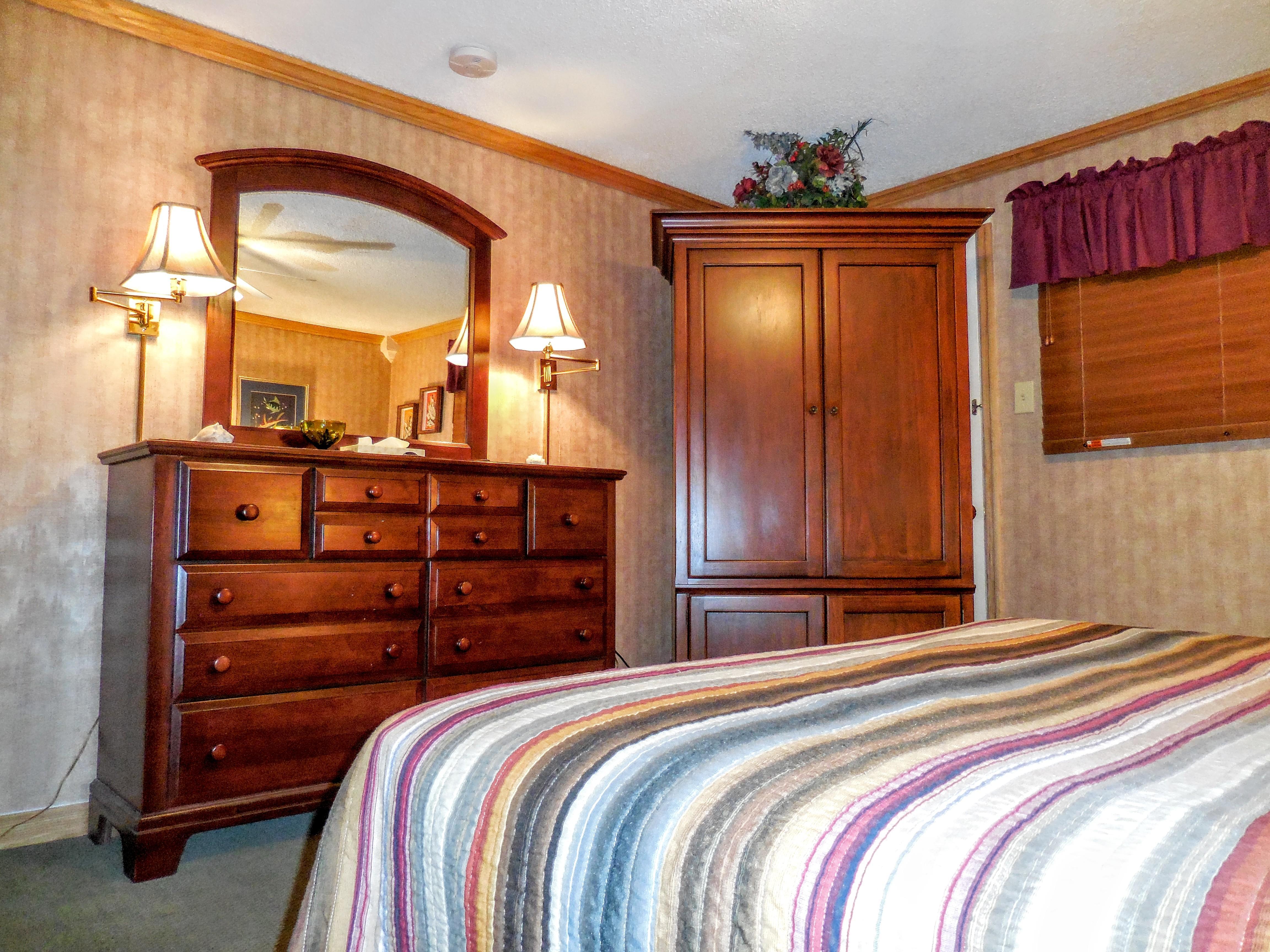 Plenty of storage in master bedroom (armoire and dresser)