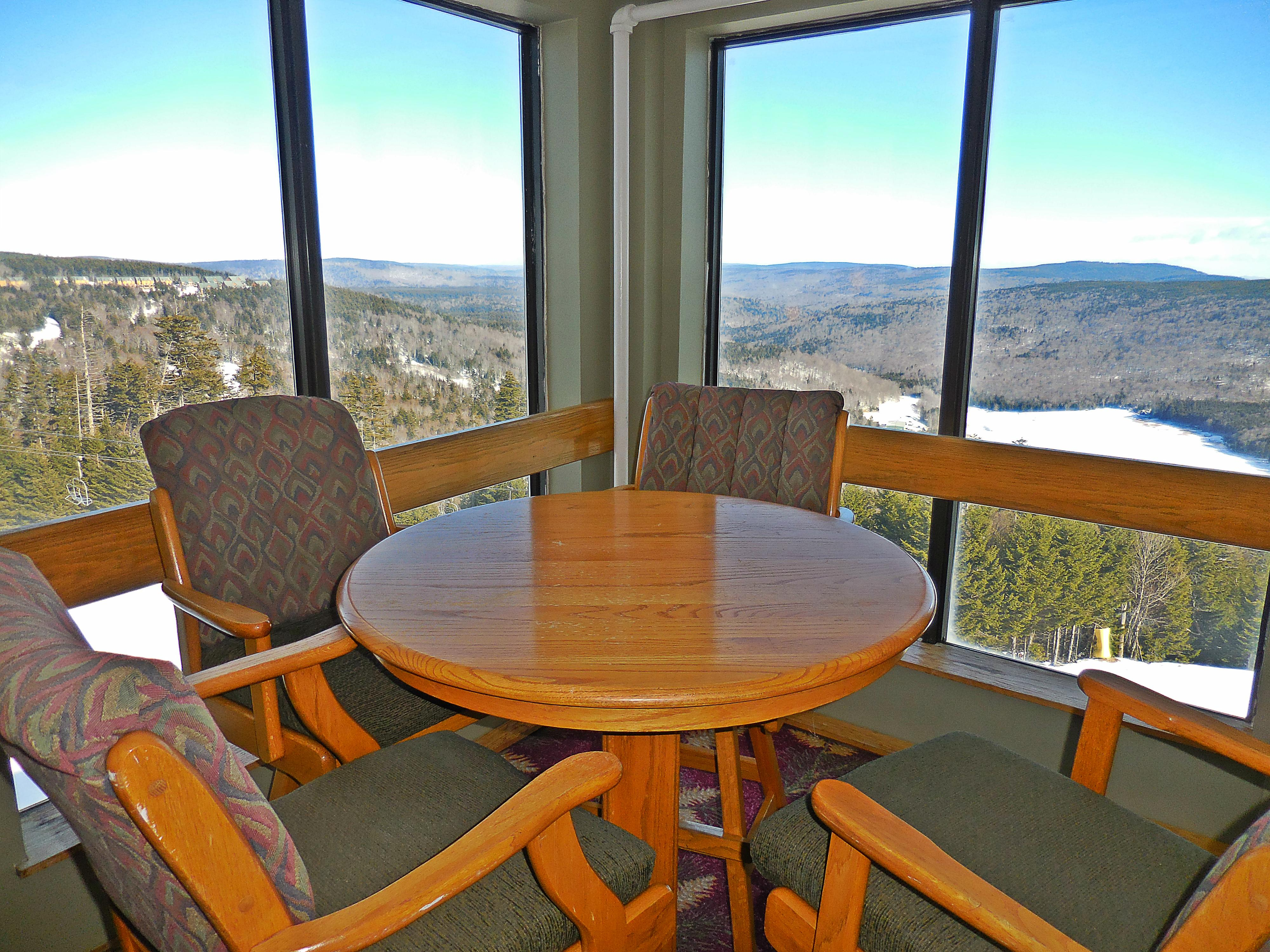 Mountain Lodge sitting areas overlook slopes and mountains