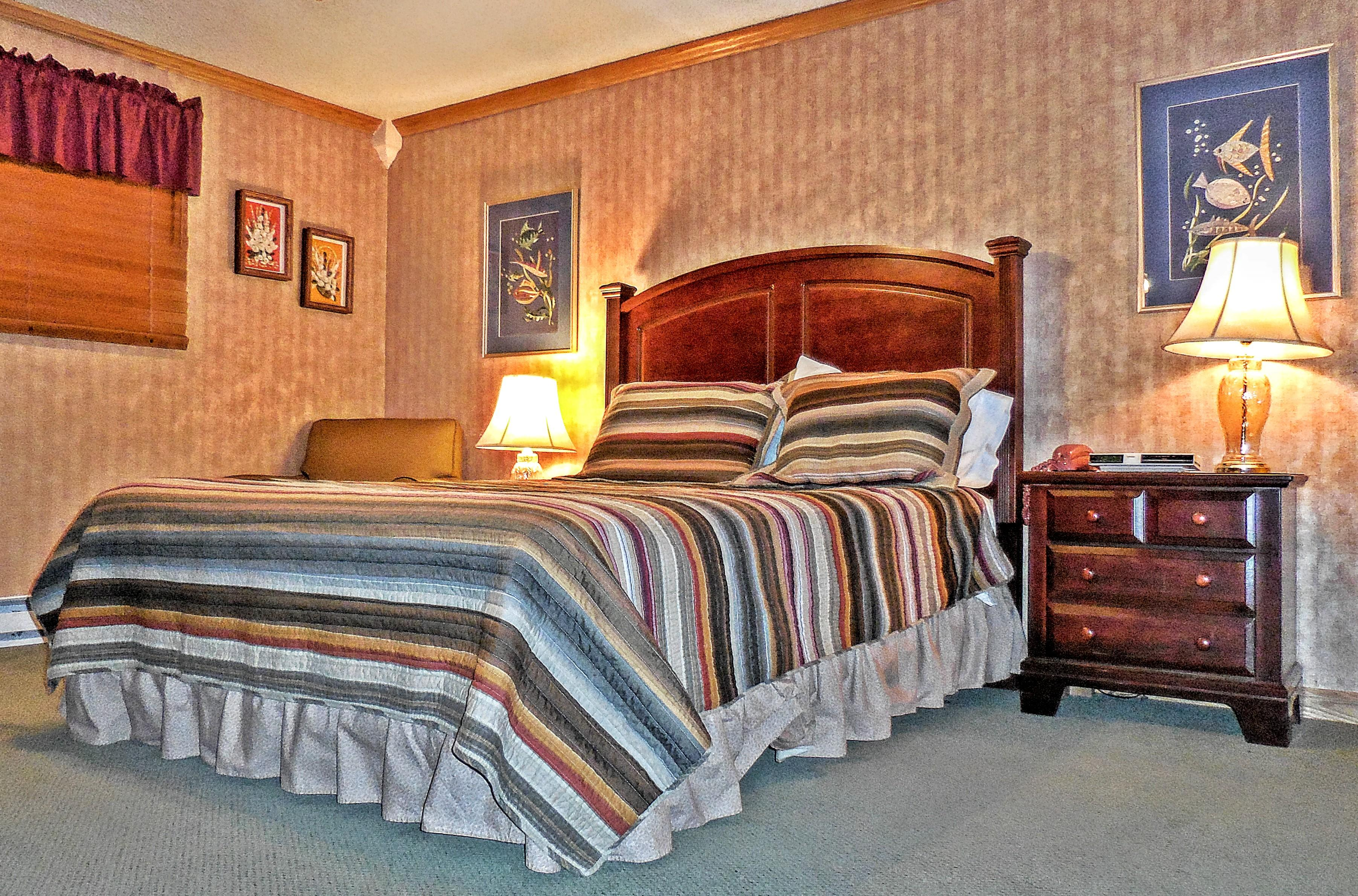 Master bedroom w/ queen bed and private full bath
