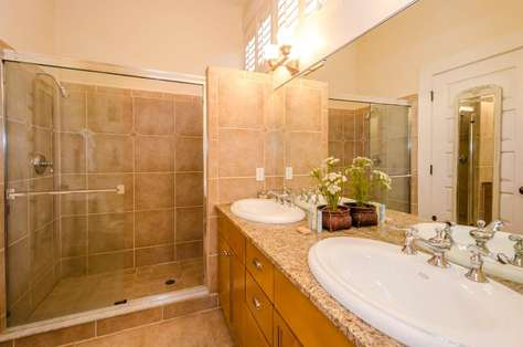First Floor Master Bathroom with dual sinks, large walk-in shower with dual shower heads