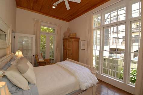 First Floor Guest Bedroom - lots of natural sunlight.  Chair and ottoman for watching TV or reading