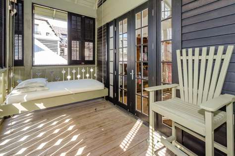 Open the shutters to enjoy the breeze through the treetops!