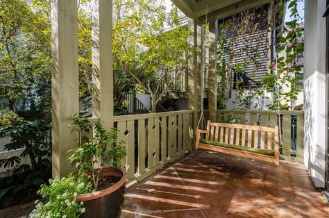 Relax on the covered, private front porch