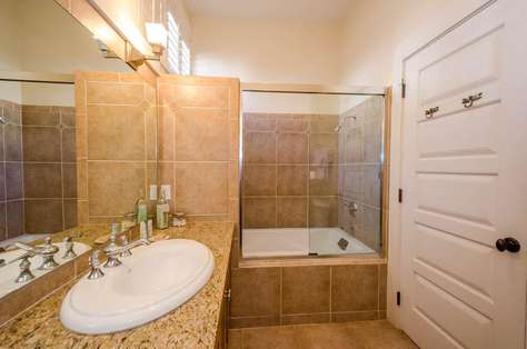 First Floor Guest Bathroom with large deep soaking tub/shower combination